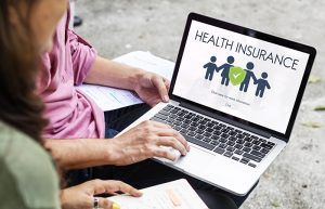Person receiving assistance enrolling in health insurance