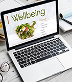 Laptop searching for wellbeing