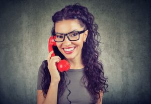 Woman smiling while dialing 211